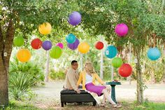 I love the hanging lanterns off trees it looks so pretty for a photo session ♡ Photography prop ideas :) Pretty and fun engagement photo idea!