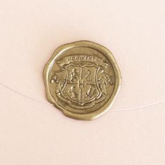 This Hogwarts seal.   19 Gifts For People Who Love Harry Potter And Also Office Supplies