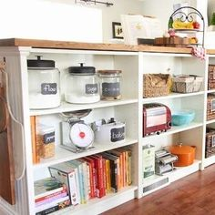 Kitchen work bench/countertop idea: find a second-hand bookcase and use it + a set of legs to support the countertop