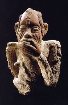 """Sotheby's 15 May 2003: Lot 80, a """"magnificent"""" Inland Niger Delta terracotta torso. The 12 3/4-inch-high work has a man grasping his chin with his hand while his tongue protrudes from his mouth and his head is covered with raised undulating serpents. The lot, which shows signs of erosion, has an estimate of $30,000 to $40,000. It sold for $36,000."""