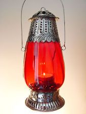 Exotic Glass Red MOROCCAN STYLE TEA LIGHT CANDLE HOLDER India Lamp LanternExotic Glass Red MOROCCAN STYLE TEA LIGHT CANDLE HOLDER India Lamp Lantern 9 watching This lantern features a beautiful mix of red colored glass and white metal, and i ntricate detailing that adds to its quality finish. Designed to set perfect ambiance for any exotic setting. 9d 9h 22m left AU $30.00 Buy It Now