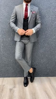 Collection: Fall – Winter Product: Slim-Fit Wool Suit Color Code: Gray – Black Combination Size: Suit Material: 70 wool, 30 polyester Machine Washable: No Fitting: Slim-fit Package Include: Jacket, Vest, Pants Only Gifts: Shirt, Chain and Neck Tie Mens Casual Suits, Dress Suits For Men, Grey Suit Men, Stylish Mens Outfits, Men Dress, Men's Suits, Mens Slim Fit Suits, Mens Prom Suits, Grey Suit Black Shirt
