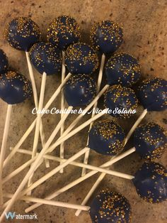 Navy blue and gold cake pops
