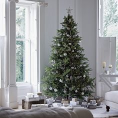 christmas tree with silver and white decorations