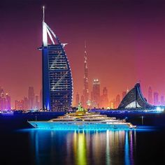 Dubai, UAE - Burj Al Arab, Jumeira Beach Hotel and, in the distance, the Burj Khalifa.