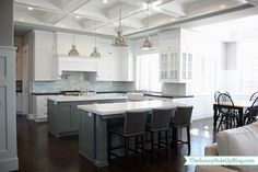 Ben Moore Chelsea Gray island #paint | Combo of black and white quartz counters