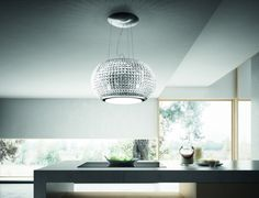 Interstellar is the new suspended Elica hood that is the ideal size cm) for island kitchen installation. Its remarkable personality makes this hood the focal piece of any space. Inside Kitchen Cabinets, Barn Kitchen, Home Decor Kitchen, Kitchen Ideas, Kitchen Hoods, Island Kitchen, Kitchen Appliances, Interstellar, Geometric Pendant Light
