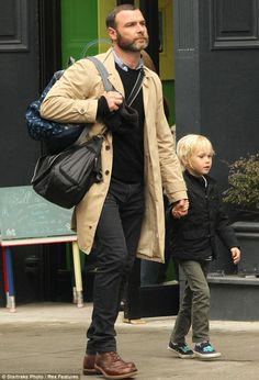 Big Apple style: He wore a beige mac jacket just like his spouse and their nanny