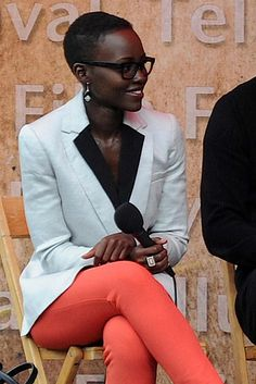 "She knows how to rock a colored pant. | Why ""12 Years A Slave"" Star Lupita Nyong'o Should Be Your New Fashion Idol"