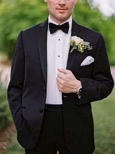 Classic black tuxedo with rose pin.