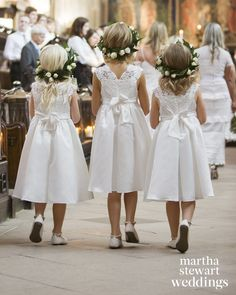 The flower girls, the couple's nieces, wore Monsoon dresses and wreaths of skimmia leaves and ivory piano roses.