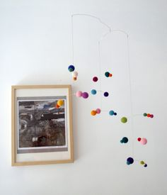would be a fun mobile to make with felted balls [using fishing weights on some of the lines to weight it properly].