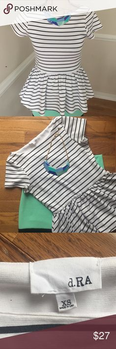 dRA Striped Peplum Top Adorable Anthropologie dRA black and white peplum top. Stretchy waist for great fit, EUC. Dress up for work or go out for drinks! Looks amazing with skinny jeans.   No trades, no PP, smoke free home.  Offers always welcome through the button or bundle your likes for a private offer! Anthropologie Tops