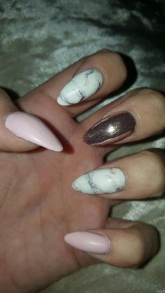 Acrylic nails , stiletto sparkle marble with a lovley pink and gold ... my fav set so far !!