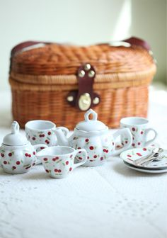 Red Cherries Play Picnic Tea Set 35.99 at shopruche.com. Perfect for playing tea for two, this adorable white porcelain tea set is adorned with a vintage-inspired cherry print. The set includes two matching cups and saucers, a teapot, creamer, a sugar pot, and two sets of metal forks and spoons. Includes a turn lock wicker basket for easy storage. Ages five and up. Hand wash with a non-abrasive cleaner.Ba...