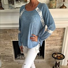 Baby blue/crochet blouse! Stunning color with a rounded hi lo hemline with white crochet detail! Tops