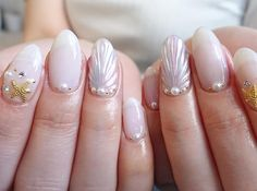 Soak up the sun and spend summer in style with these mermaid shell nails, the latest Japanese nail art trend that's making waves on Instagram.