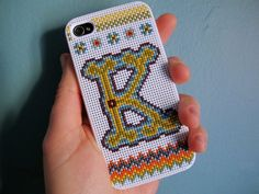 cross stitch makes these handheld devices so pretty