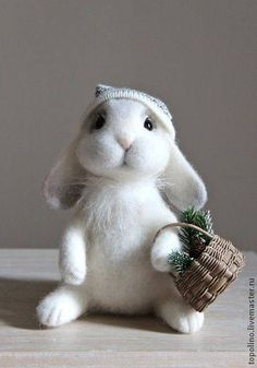 Felted rabbit with a basket.   The easter bunny came early