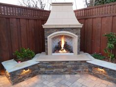 Lit Outdoor Fireplace & Sitting Wall with low-voltage lighting - Yelp Outside Fireplace, Backyard Fireplace, Cozy Backyard, Backyard Retreat, Fire Pit Backyard, Backyard Ideas, Fireplace Outdoor, Pergola Ideas, Outdoor Rooms