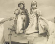 Two Parisian dolls belonging to the Princesses Elizabeth and Margaret shown nearly 80 years ago - the two Princesses' tiny hands can be seen