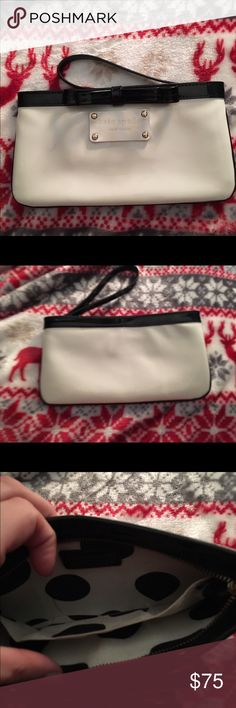 NWOT Kate Spade Patent Leather Bow Wristlet/wallet Adorable kate spade new york wristlet. This is white patent leather with black patent leather trim and a black patent leather wristlet strap.   Has a zipper on the top and 2 small slide pockets on the inside. It is made to fit a phone (depending on the size), cards, and lipstick. Similar kate spade wristlet options retail for $98+ Very cute, very classy, and especially love that signature kate spade bow detail! kate spade Bags Clutches…