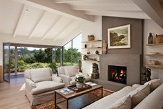 gray stucco fireplace with floating shelves