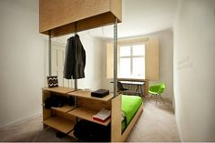 I also really like the room with the two beds and the neat shelving in the middle. A hotel I would love to stay at!