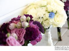This bride did her something blue in her bouquet!  Beautiful ivory and purple bouquets.