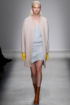 Were you cleaning your toilet prior to this fashion show? The reason I ask is because you seem to have forgotten to remove your yellow rubber gloves. Hand them to me; I won't say anything.