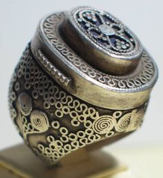 Large silver poison ring from Kazakhstan. The top opens to a compartment where one can hide poison or smply your medecine.