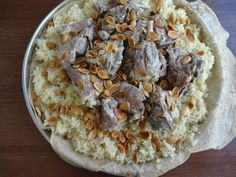 This Jordanian dish is similar to Maqluba. Except this dish is not served upside down ! Another way this dish differs is the toppings that can be mixed with it. Such as yogurt mixed with broth, peanuts and pine nuts.