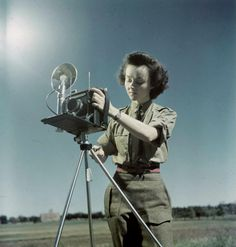 CWAC photographer Sgt. Karen Hermiston, the first woman photographer in the Canadian Army with a Speed Graphic camera ~