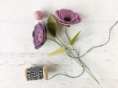 N e w D e s i g n ! Mini Felt Flower Bouquet - Rolled Flowers and Pom on Wire Stems These freshly-cut flowers will never wilt and die! They are hand-cut and rolled, so each one is a little different...just like the real ones! Bouquet comes with a little bundle of 2 rolled flowers and a single wool pom, attached to a 9 wire stem. Stems are bendable, for easy arranging. New leaf design allows you to move the leaf up or down on the stem and side to side. The Bouquet can be made with any color…
