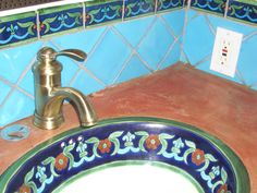 tile bathroom turquoise - with spanish tile accents and concrete top of vanity and spanish sink