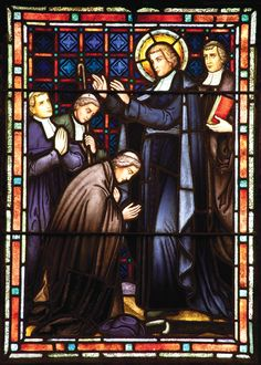 Life of St. John Baptiste de la Salle in stained glass, Saint Mary's College Chapel.  De la Salle blesses three Christian Brothers as they prepare to follow their call to teach and educate the poor in Rome.