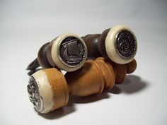 These are homemade seals using shank buttons and old chess pieces - totally brilliant!