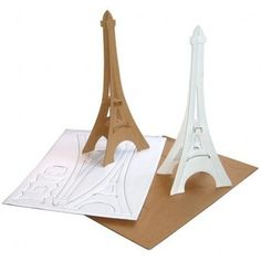 cardboard Eiffel Tower - my mom and I figured out that you can do these out of large cardboard boxes and make a 6' tower.