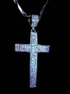 The photos dont even come close to the diamond like sparkle that comes off these 315 tiny czs. A VERY impressive 3 1/2 long cross that will blind anyone who sees it in the sun.. A stunning stainless steel setting that could be worn by a man or a woman. The 30 chain is well made and finishes off this awesome bling bling. And remember, a personal well thought out gift shows you took the time to care about that special person in your life. Our items are classic, sometimes unusual and vintag...
