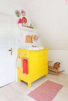 Bright yellow changing table