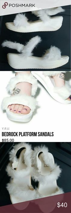 YRU bedrock platform sandals YRU White bedrock platform sandals. Purchased for $85. Took em up to red rock hiking once because why not so now they have an orange tint. Haven't tried cleaning em. Size 7. #yru #platforms #platformsandals #kawaii #aesthetic #harajuku #fluffy #fauxfur #dollskill YRU Shoes Sandals