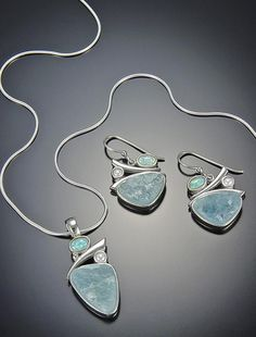 Nancy Markoe Gallery, St. Pete Beach March Birthstone-Aquamarine. New is uncut aqua adding depth and texture to jewelry pieces. Here set in Sterling Silver is uncut aqua and pearls. Perfect stones for the water sign of Pisces. . . and romantic as their nature.