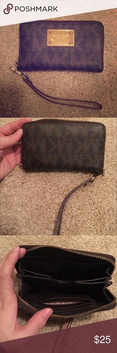 Michael Kors iPhone 5 Wristlet Brown leather medium Michael Kors wristlet. Fits iPhone 5. Some scratches on plate but in great condition. Michael Kors Bags Clutches & Wristlets
