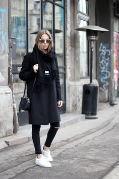 You simply can't go wrong with an all black outfit consisting of skinny black jeans and an overcoat, like this one by Vanja Milicevic. Try breaking up the black by pairing the look with white sneakers, or perhaps a coloured beanie! Jeans/Coat: Zara, Sweater: C&A, Scarf: Acne, Bag: Gucci, Sneakers: Adidas.