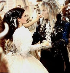 1986 - Jennifer Connelly as Sarah and David Bowie as Jareth in Labyrinth film. David Bowie Labyrinth, Labyrinth 1986, Labyrinth Movie, Masquerade Costumes, Masquerade Ball, Labyrinth Goblins, Sarah And Jareth, Labrynth, Goblin King