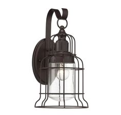 The Outdoor Living Transitional style Scout Large Wall Lantern from Savoy House is finished in English Bronze. The collection of Scout outdoor wall lanterns from Savoy House are a stylish combination of vintage-inspired cage structures, an Engl Outdoor Sconces, Outdoor Wall Lantern, Outdoor Wall Lighting, Exterior Lighting, Outdoor Walls, Lighting Sale, Lighting Stores, Lighting Ideas, Lighting Design
