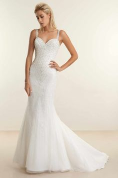 471a903183d00 This timeless fit n  flare gown features a delicate beaded chevron bodice  and a sweetheart