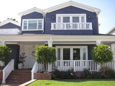 house is white vinal red roof with stone wainscot and navy blue accents - Google Search