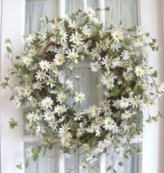 Spring wreath  I love daisies and this is pretty! To make it stand out for the road view I might add some yellow daisies as well…just a thought...
