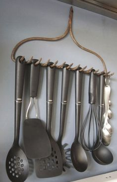 Secure an old steel rake on the wall and use the tongs to hang kitchen utensils.